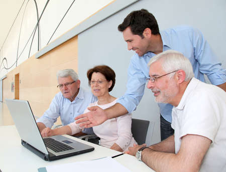 senior adult men: Group of senior people attending job search meeting