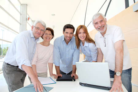 training consultant: Group of happy senior people in training course