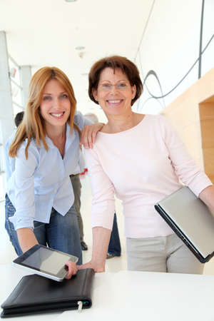 Portrait of smiling women in business training photo