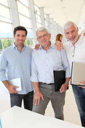 Portrait of smiling men in business training photo