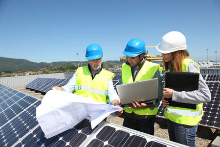 Group of engineers meeting on building roof Stock Photo - 9634934
