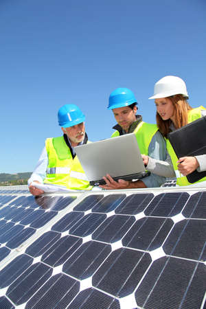 Group of engineers meeting on building roof Stock Photo - 9634970