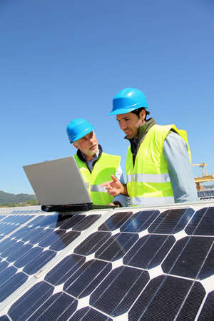 Engineers checking solar panel setup Stock Photo - 9634956