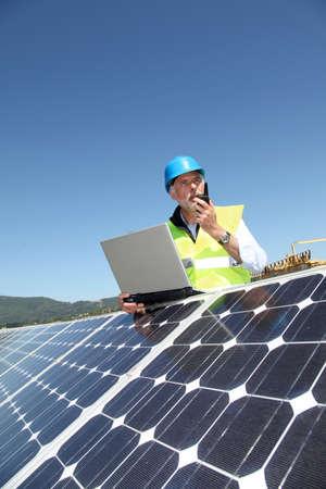 Engineer checking photovoltaic installation Stock Photo - 9634917