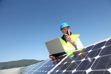 Engineer checking photovoltaic installation Stock Photo - 9634726