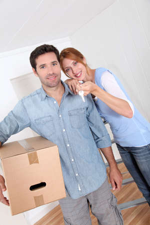 Happy couple buying new house photo