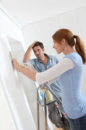 reforming: Couple choosing wallpaper color for new house