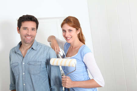Couple painting new apartment photo