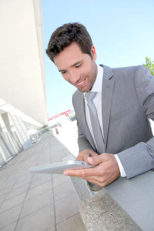 30 years old man: Businessman using electronic tablet outside a building Stock Photo