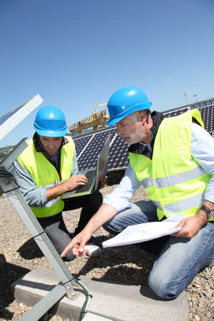 lifevest: Engineers checking solar panels running