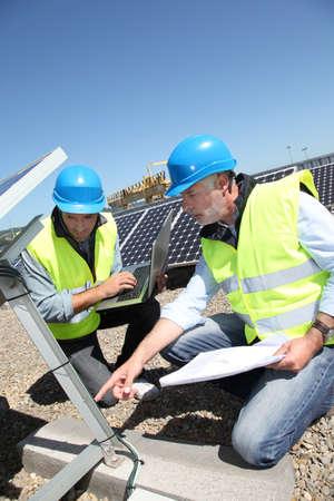 light worker: Engineers checking solar panels running