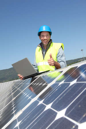 Engineer checking photovoltaic installation Stock Photo - 9635005
