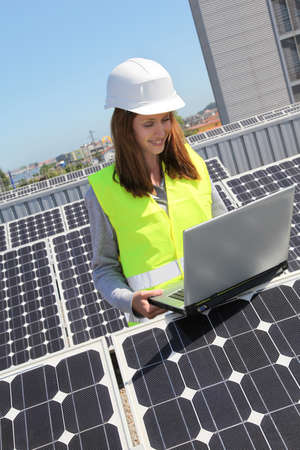 Woman engineer on solar panels site photo