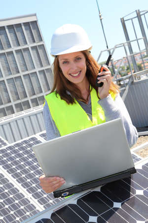 lifevest: Woman engineer on solar panels site