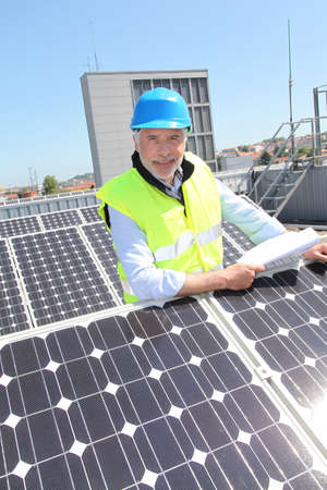 Engineer checking photovoltaic installation Stock Photo - 9635207