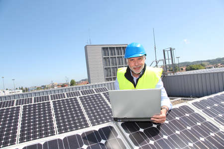 Engineer checking photovoltaic installation photo