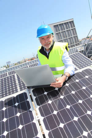Engineer checking photovoltaic installation Stock Photo - 9635206