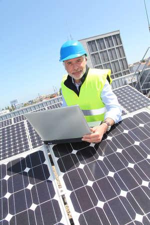 Engineer checking photovoltaic installation Stock Photo - 9635206