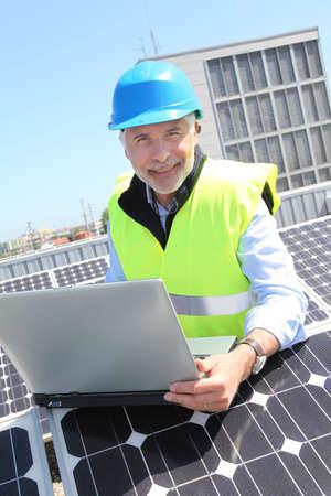 Engineer checking photovoltaic installation photo