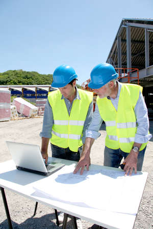 Industrial people working on building site Stock Photo - 9635090
