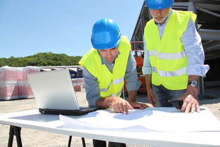 Industrial people working on building site Stock Photo - 9635078