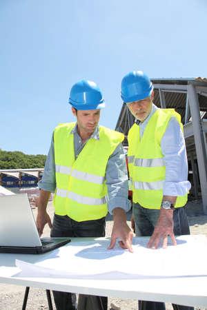 btp: Industrial people working on building site