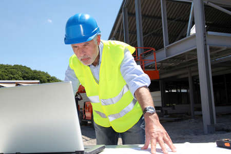 buildingsite: Engineer with security helmet on construction site