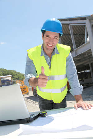 Happy worker on construction site Stock Photo - 9635001