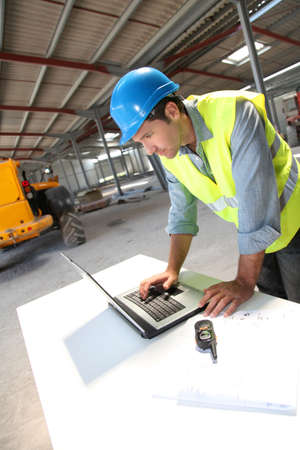 lifevest: Engineer using laptop computer on construction site