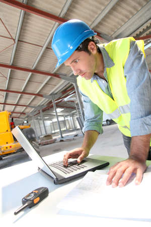 buildingsite: Engineer using laptop computer on construction site