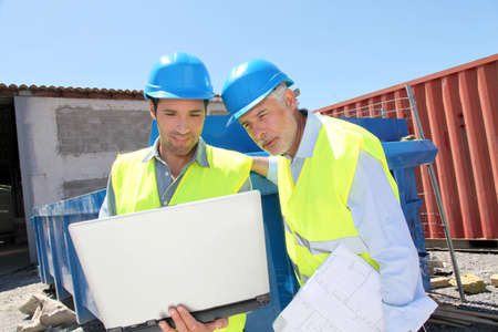 buildingsite: Engineers meeting on building site