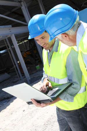 Engineers meeting on building site