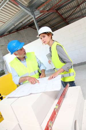Construction workers meeting on building site Stock Photo - 9635156