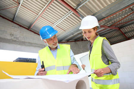 buildingsite: Construction workers meeting on building site