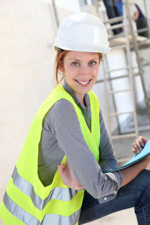 buildingsite: Woman engineer standing on building site Stock Photo