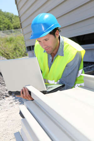 buildingsite: Engineer with laptop computer on building site