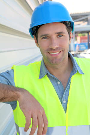 Portrait of young worker with security helmet photo