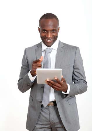 happy businessman: Businessman on white background using electronic tablet Stock Photo