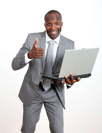 Joyful businessman with laptop computer photo