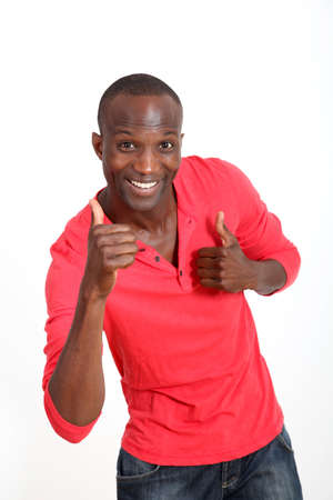 thumbs up: Handsome black man with cheerful attitude