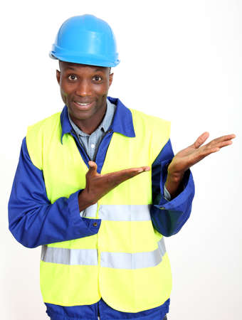 Construction worker standing on white background photo
