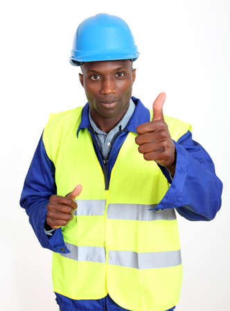 lifevest: Construction worker showing thumb up Stock Photo