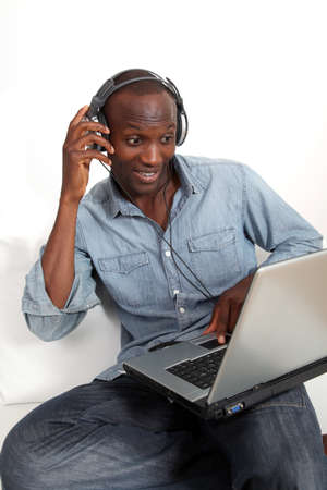 Black man listening to music on internet photo