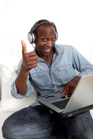 Black man listening to music on internet photo