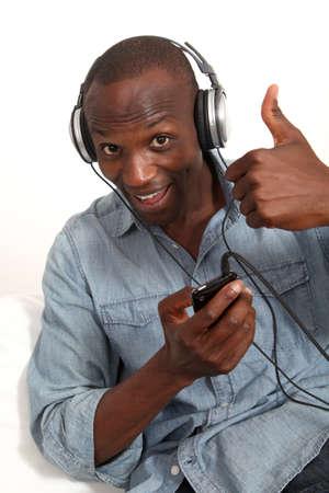 Cheerful man listening to music  photo