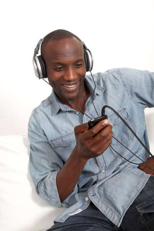 Cheerful man listening to music  photo