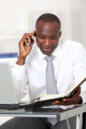 Businessman talking on the phone in office photo