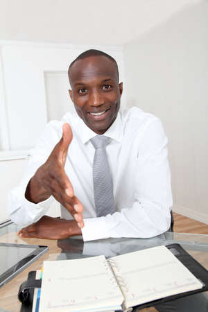 job satisfaction: Businessman in office for an interview