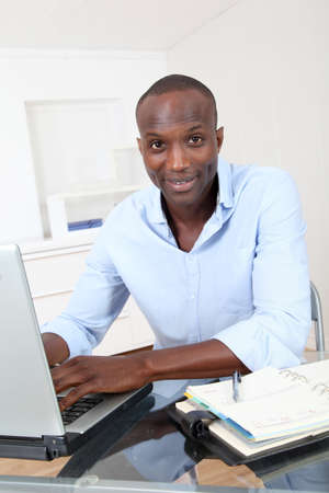 Office worker working on laptop computer Stock Photo - 9637971