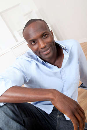 Handsome black man relaxing at home Stock Photo - 9638927